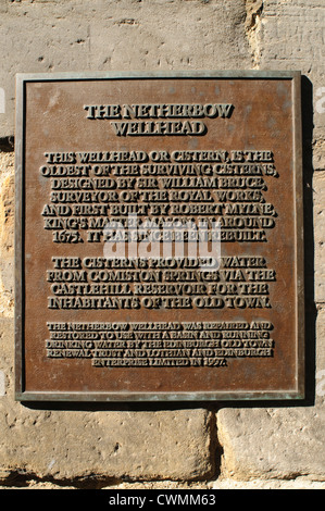 Information plaque on the Netherbow wellhead, outside John Knox house on the  Royal Mile, Edinburgh, Scotland, UK. - Stock Photo