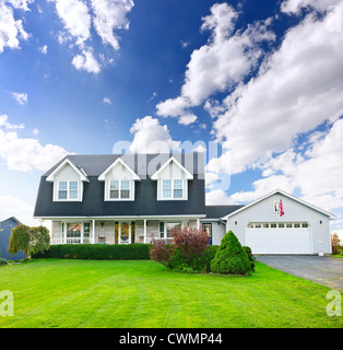 Beautiful two storey residential house with dormers and attached garage - Stock Photo