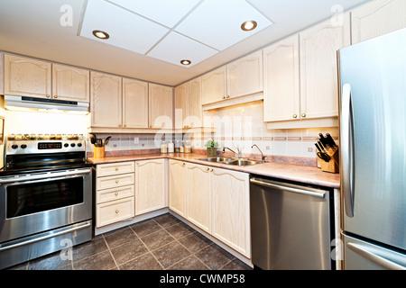 Modern luxury kitchen with stainless steel appliances - Stock Photo