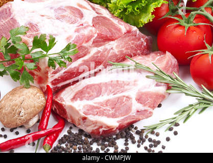 Still life with raw pork meat and fresh vegetables - Stock Photo