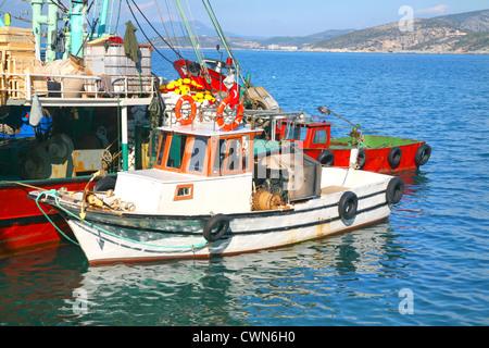 Turkish fishing boats tied up in Kusadasi, Turkey. - Stock Photo