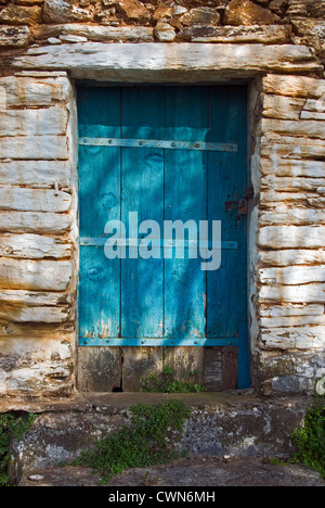 Weathered wooden door of an old stone cottage on Pelion Peninsular, Thessaly, Greece - Stock Photo
