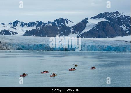 Kayaking in front of 14 July Glacier, Spitsbergen, Svalbard, Arctic - Stock Photo