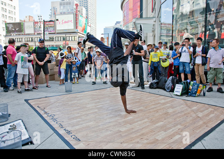 Breakdancing or Brake Dancing by Street Performers in downtown Toronto on Yonge and Dundas in Toronto;Ontario;Canada - Stock Photo