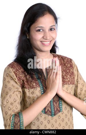 Beautiful Indian woman greeting 'NAMASTE' - Stock Photo