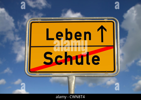 German road sign school and life with blue sky and white clouds - Stock Photo