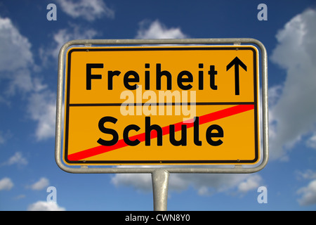 German road sign school and freedom with blue sky and white clouds - Stock Photo