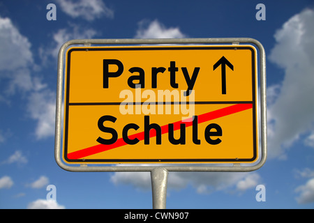 German road sign school and party with blue sky and white clouds - Stock Photo