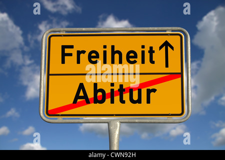 German road sign graduation and freedom with blue sky and white clouds - Stock Photo