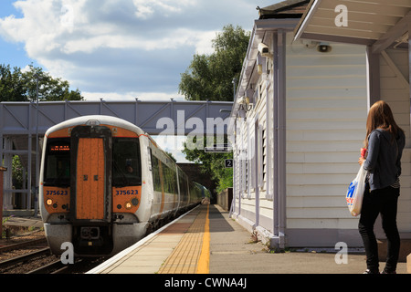 Passenger waiting for SouthEastern train approaching country railway station on London to Ashford line. Pluckley - Stock Photo