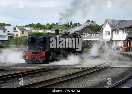 Steam train on the welsh highland railway at porthmadoc,wales - Stock Photo