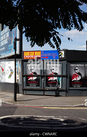 Adshells, Advertising hoardings and back-lit poster and design on the street of London UK. - Stock Photo