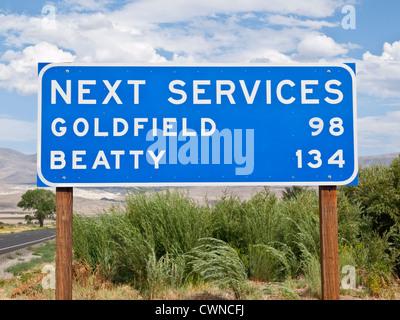 Next services sign in the middle on nowhere. - Stock Photo