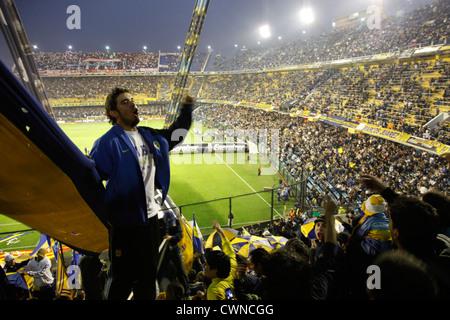 Football match of Boca Juniors at the Bombonera stadium, La Boca, Buenos Aires, Argentina. - Stock Photo