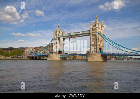 Tower Bridge in London which crosses the River Thames it has the Paralympic symbol on the top during the games 2012 - Stock Photo
