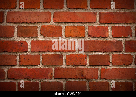 old red brick wall background with shadows in corners - Stock Photo