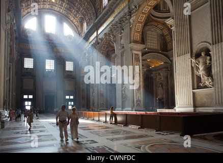 Crepuscular rays are seen in St. Peter's Basilica in the Vatican City.