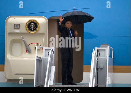 US President Barack Obama waves before boarding Air Force One August 22, 2012 at Nellis Air Force Base, Nevada. - Stock Photo