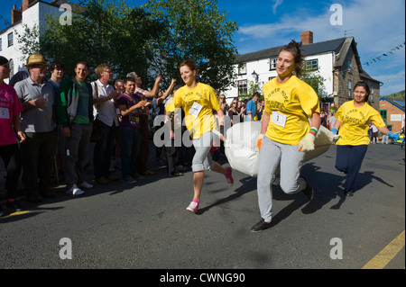 East European ladies team taking part in the annual World Championship Hop Pocket Race at Bromyard Herefordshire - Stock Photo