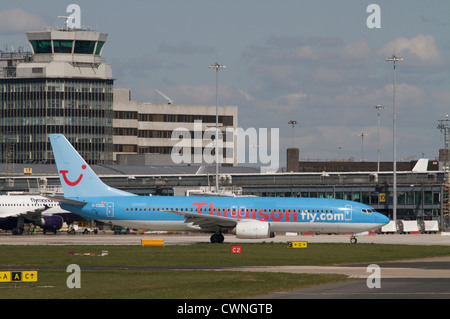 Thomsonfly (Thomson Airways) Boeing 737-804 leaving the terminal at Manchester Airport - Stock Photo