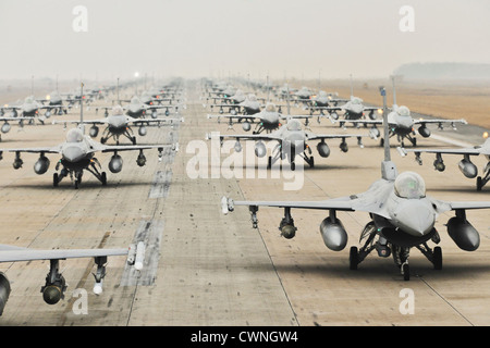 US F-16 Fighting Falcons demonstrate an Elephant Walk as they taxi down a runway, during an exercise March 2, 2012 - Stock Photo