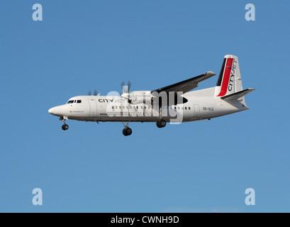 CityJet Fokker 50 on approach to London City Airport - Stock Photo