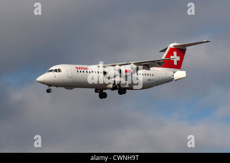 Swiss European Air Lines Avro RJ100 regional jet or small airliner flying on approach with tail airbrakes open. - Stock Photo
