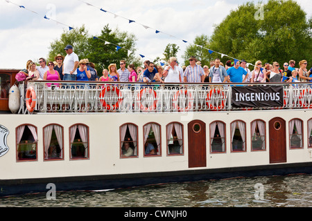 Festival goers arriving at the Rewind Festival Henley on Thames 2012 by paddle steamer from Henley town centre. - Stock Photo