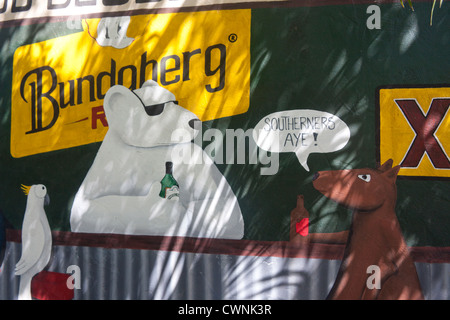 Mural / wall painting at cafe with kangaroo, polar bear and cockatoo sitting in bar with XXXX and Bundaberg signs - Stock Photo