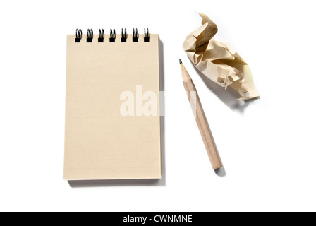 Notepad, blank, with a pencil and a piece of crumpled paper, isolated on 100% white background - Stock Photo