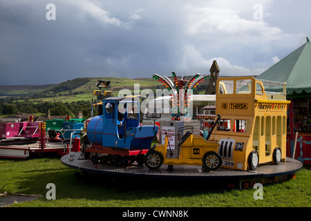 Barrys Fun Fair roundabout on Reeth Village Green, North Yorkshire Dales, Richmondshire, UK - Stock Photo