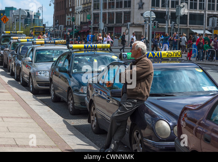 Cabbie at Dublin Taxi rank in City Centre, Republic of Ireland. - Stock Photo