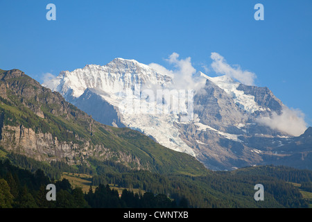 Famous mount Jungfrau in the swiss alps as seen from village Wengen - Stock Photo