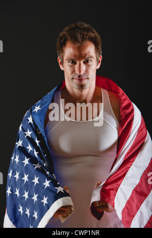 Athlete covered with American flag, portrait - Stock Photo