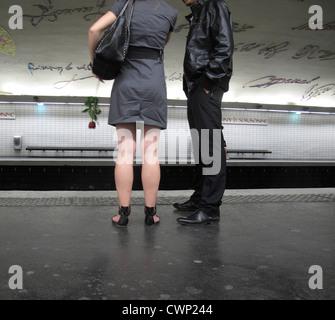 Couple waiting on subway platform - Stock Photo
