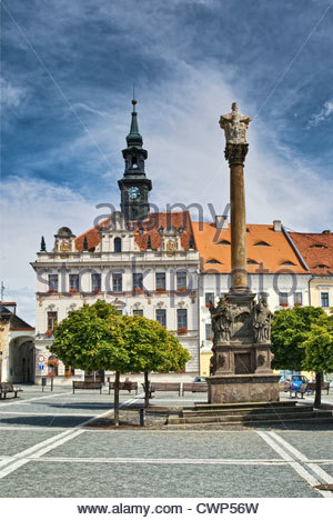 Plague column and town hall at Náměstí Masaryka in Česká Lípa in Liberecky kraj (Liberec Region), Czech Republic - Stock Photo