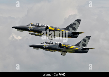 A pairs take off from 2x Aero L39 Albatross aircraft of the Breitling jet team - Stock Photo