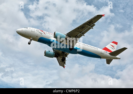 An Airbus A320 of Austrian airlines on final approach - Stock Photo