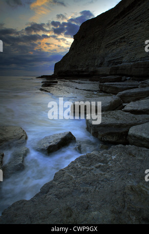 View of rock formations and cliffs in rugged bay at sunset, Dunraven Bay, Southerndown, Glamorgan Heritage Coast, - Stock Photo