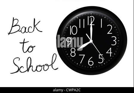 Back to school concept, handwriting on a white chalkboard with big black clock - Stock Photo
