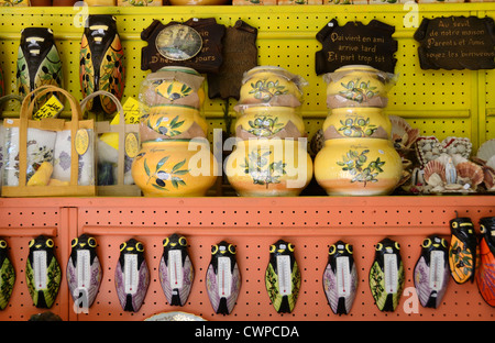 Souvenirs, Bric-a-brac or Knick knacks of Cicada Thermometers & Pottery Decorated with Olives For Sale in Gift Shop Fontaine-de-Vaucluse Provence