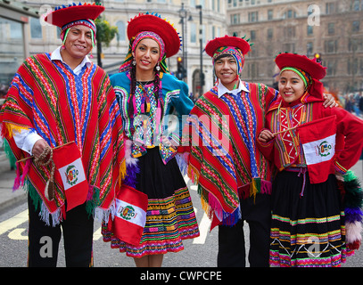 UK. England. London. Four people in traditional Peruvian costume during Chinese New Year celebrations. - Stock Photo