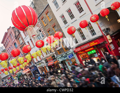 UK. England. London. Crowds in Chinatown during Chinese New Year celebrations. - Stock Photo