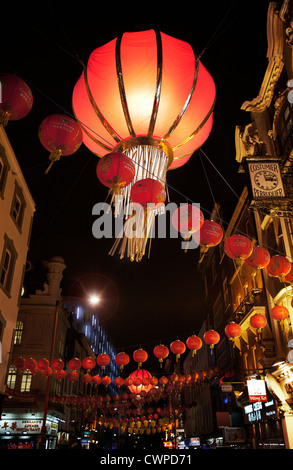 UK. England. London. Hanging lanterns in night street scene. Chinatown during Chinese New Year celebrations. - Stock Photo
