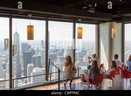 Tourists looking out over city skyline from the observatory on John Hancock Center, N Michigan Avenue, Chicago, - Stock Photo