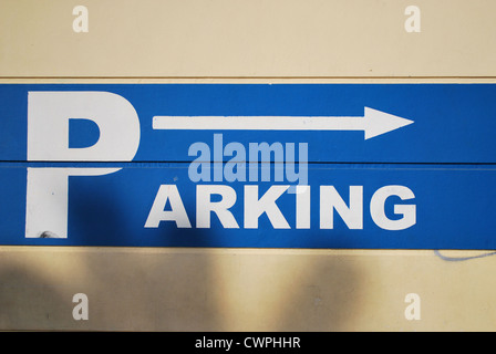 Blue Parking Lot Sign - Stock Photo