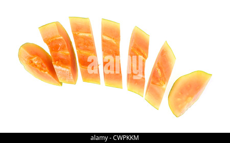 Half of a maradol red papaya in slices on a white background. - Stock Photo