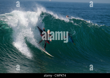 Surfer riding a huge wave at the Wedge Newport Beach California in September 2012 - Stock Photo