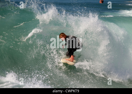 Surfer riding a huge  at the Wedge Newport Beach California in September 2012 - Stock Photo