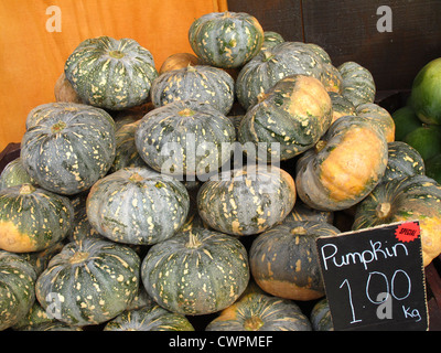 A stack of pumpkins for sale - Stock Photo